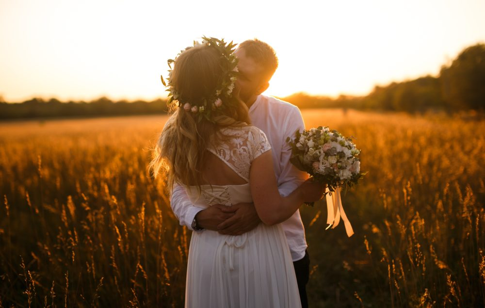blurred-background-bride-and-groom-cropland-1573007